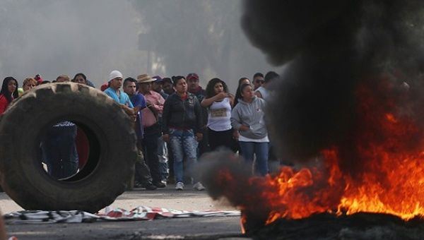 Protesters block the entrance to a Pemex gas station as they burn tires during a protest against the rising prices of gasoline enforced by the Mexican government, in San Miguel Totolcingo, Mexico January 3, 2017.