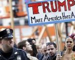 People take part in an anti-Donald Trump, pro-immigration protest.