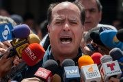 Opposition lawmaker Julio Borges speaks to media outside the Palace of Justice in Caracas, Venezuela, Sept. 4, 2015.
