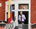 WikiLeaks founder Julian Assange speaks to the media outside the Ecuador embassy, London, Aug. 19, 2012.
