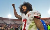San Francisco 49ers quarterback Colin Kaepernick pumps his fist as he acknowledges the cheers from fans.