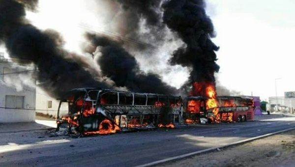 Buses burning in the city of Ixmiquilpan, Hildago in Mexico, Jan. 5, 2017.