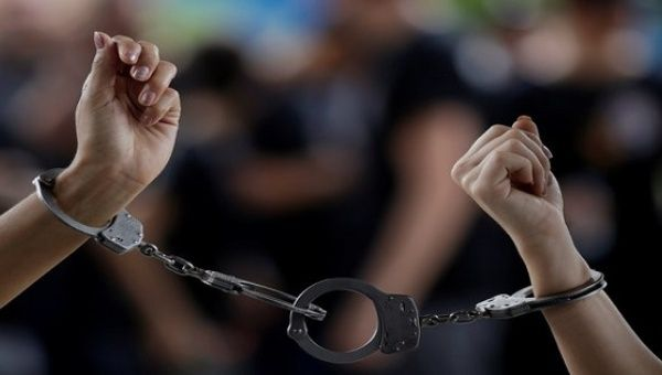 Forensic experts of the Civil Police are handcuffed during a protest against bad working conditions and low pay in front of the Court of Justice in Manaus, Brazil, January 5, 2017.