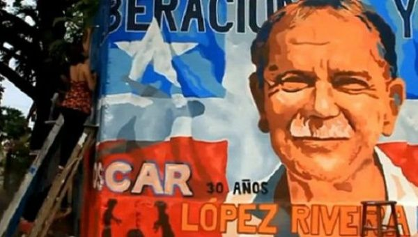 A woman works on a mural calling for the liberation of Oscar Lopez Rivera, San Juan, Puerto Rico.