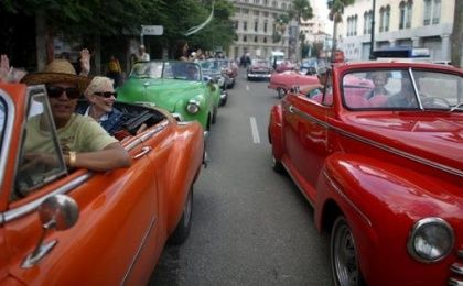 Tourists enjoy a ride in vintage cars in old Havana in this Jan. 17, 2016.