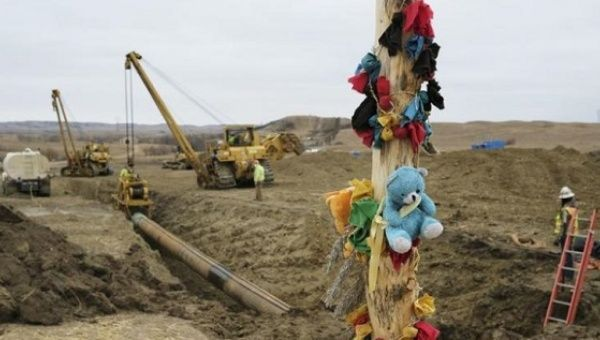A log adorned with colorful decorations remains at a Dakota Access Pipeline protest encampment as construction work continues on the pipeline near the town of Cannon Ball, North Dakota.
