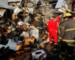 Firemen gather at the site of a car bomb attack at a vegetable market in eastern Baghdad, Iraq , Jan. 8, 2017.
