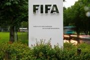 Cars drive past a logo in front of FIFA's headquarters in Zurich, Switzerland, June 8, 2016.