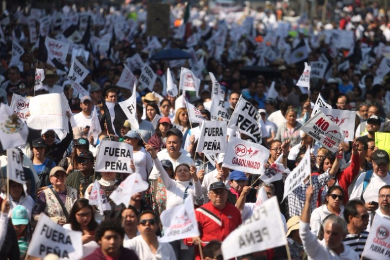 Protesters march during a demonstration against the rising prices of gasoline enforced by the Mexican government at downtown in Mexico City.