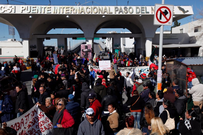 Demonstrators take part during a protest against the rising prices of gasoline enforced by the Mexican government, at Paso del Norte international border crossing bridge in Ciudad Juarez.
