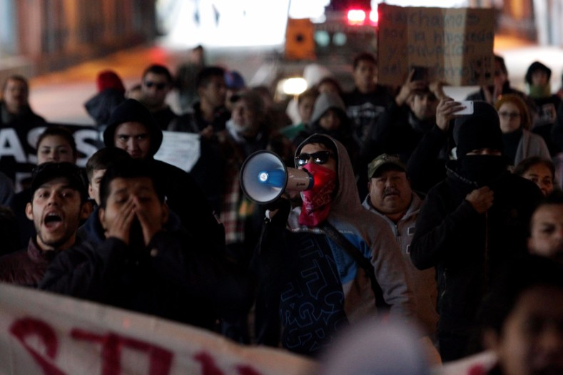 Demonstrators march during a protest against the rising prices of gasoline enforced by the Mexican government at the Macroplaza in Monterrey.