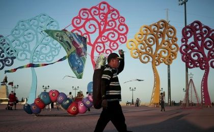 A man sells kites alone the malecon in Managua, Nicaragua.