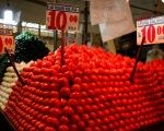 Tomatoes are displayed at a vegetable stall in La Merced market, downtown Mexico City, Jan. 31, 2013.