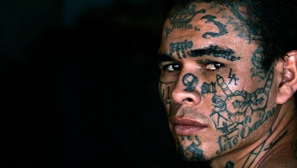 A former leader of the Mara Salvatrucha or M13 gang, poses during a photo session at Comayagua jail in Honduras in February 2008.