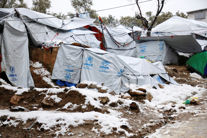 Snow lays next to tents provided by the UNHCR at the refugee camp of Moria on the Greek island of Lesbos, Jan. 10, 2017.