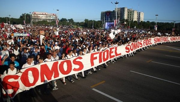 "People march with a banner that reads ""We are all Fidel"" in Havana, Cuba, Jan. 2, 2017."