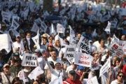 Protesters march during a demonstration against the rising prices of gasoline enforced by the Mexican government in Mexico City.