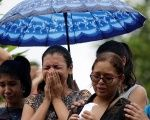 Relatives attend the funeral of one of the inmates who died during a prison riot, at the cemetery of Taruma in Manaus.