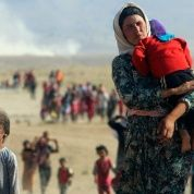 Displaced people from the minority Yazidi sect fleeing violence in Sinjar town, near the Syrian border, Aug. 11, 2014.