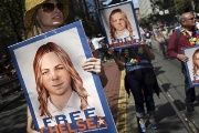 People hold signs calling for the release of imprisoned whistleblower Chelsea Manning in San Francisco, California June 28, 2015.