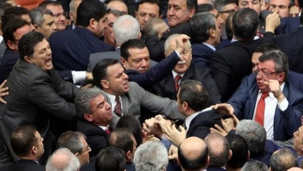 Lawmakers from ruling AK Party and the main opposition CHP scuffle during a debate on the proposed constitutional changes at the Turkish Parliament in Ankara.
