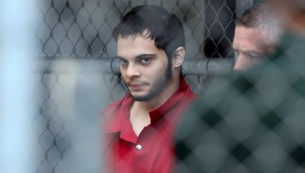 Esteban Santiago is taken from the Broward County main jail as he is transported to the federal courthouse in Fort Lauderdale, Florida.