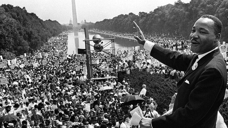 Martin Luther King, Jr. waving at crowd at historic Washington, D.C. march,