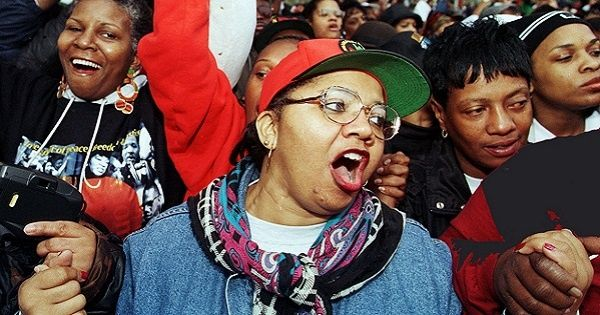 Participants of the Million Woman March sing in Philadelphia, Pennsylvania, Oct. 25, 1997.