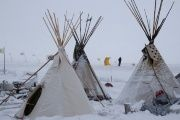 Teepees dusted in snow at the Oceti Sakowin camp.