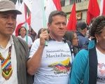 Huber Ballesteros (C) at an agrarian march in Colombia.