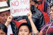 "Indigenous protesters hold a sign saying ""no more corruption"" in Guatemala City, August 2015"