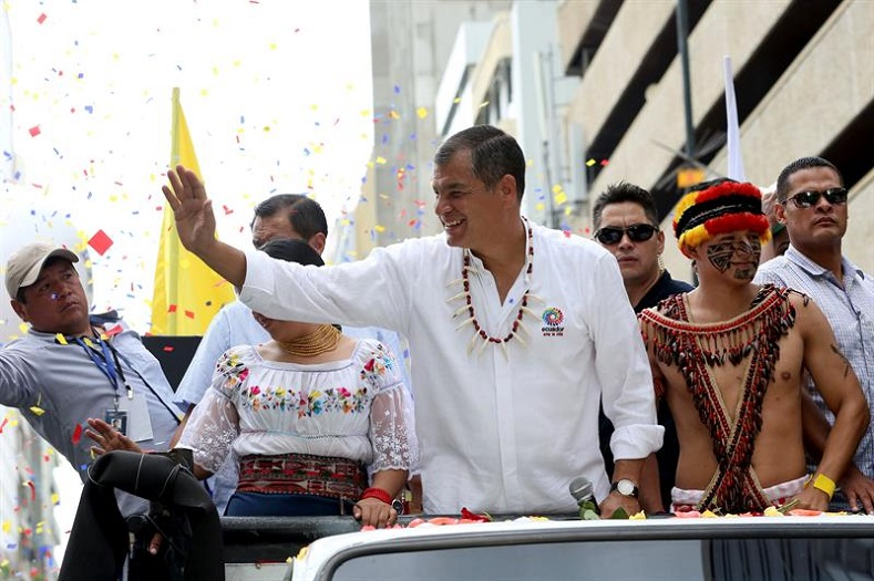 Rafael Correa waves at supporters in Guayaquil.