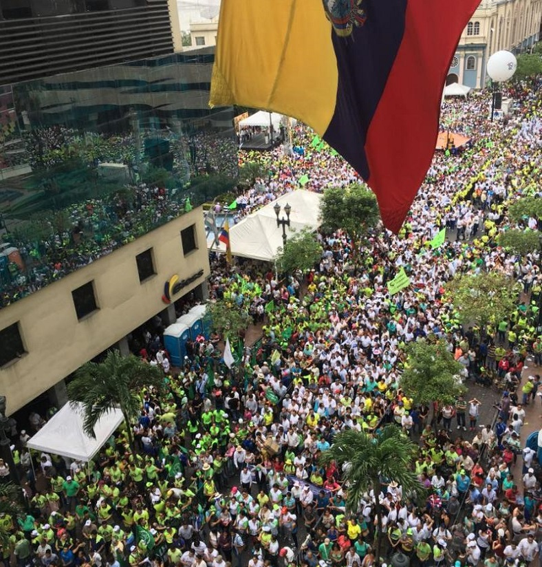 Thousands of Ecuadreans fill the streets to celebrate 10 years of poverty reduction and social gains.