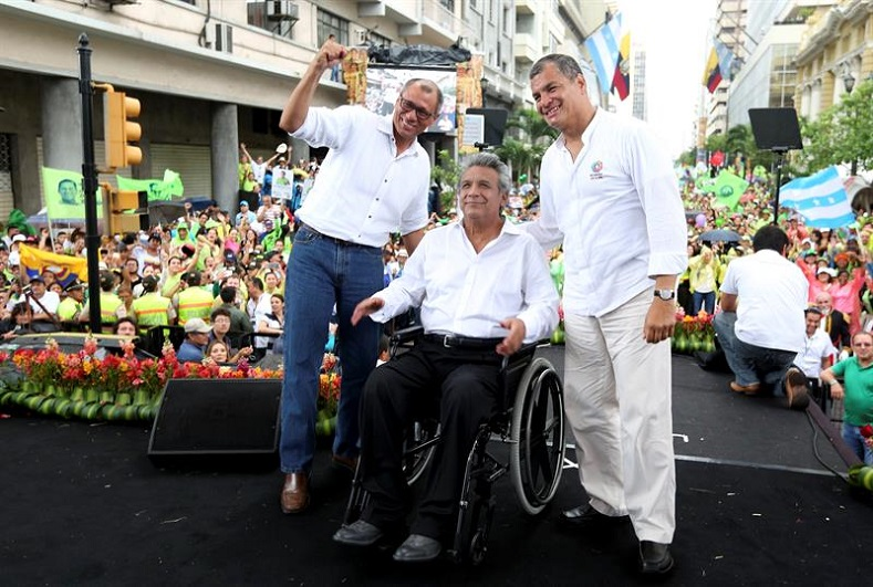 Lenin Moreno (C), in a wheelchair since being shot in an assault in 1998, is running for president with Correa