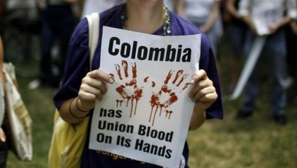 A demonstrator protests the U.S.-Colombian Free Trade Agreement.