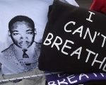 T-shirt of MLK next to one recalling the murder of Eric Garner who was strangled to death by the NYPD.