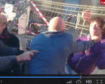 A video grab of the security guard tackling the teenager.