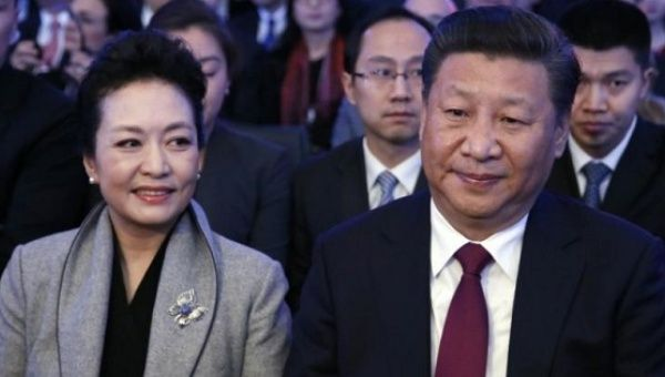 Chinese President Xi Jinping (R) and his wife Peng Liyuan attend the World Economic Forum (WEF) annual meeting in Davos, Switzerland Jan. 17, 2017.