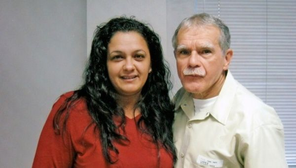 Clarisa Lopez Ramos (L) and her father Oscar Lopez Rivera (R) during a prison visit