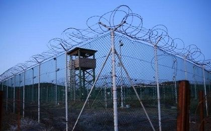 Chain link fence and wire surrounds a deserted guard tower in Joint Task Force Guantanamo