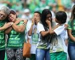 Relatives of players of Brazilian soccer team Chapecoense, who perished in a plane crash, react before a charity match between Chapecoense and Palmeiras.