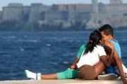 Teenagers kissing on the malecon in Havana.