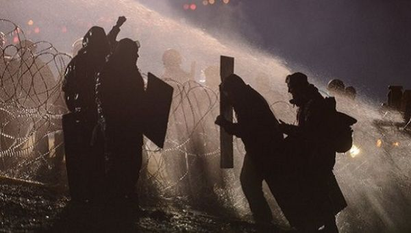 Police use a water cannon on Standing Rock protesters last November.