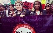 Members of the Radical Monarchs girls troop join the Women's March in Oakland.