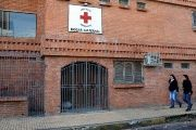 Women walk past a Red Cross maternity home in Asuncion, Paraguay.