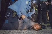 A police officer arrests a protester outside Ferguson, Missouri.