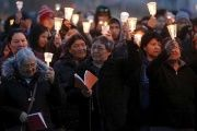 People take part in a march and candlelight vigil in the Attawapiskat First Nation.
