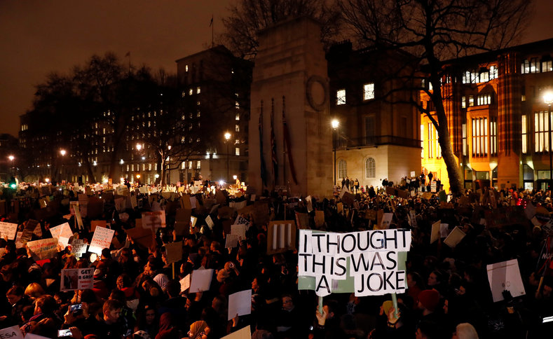 The protesters in London are calling on the government to cancel Donald Trump