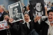 Members of the Mothers of the Plaza de Mayo celebrate a sentence against former dictatorship operatives in Tucuman, Argentina, Aug. 28, 2008.