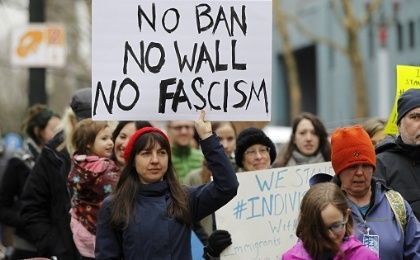 Activists march to protest against President Donald Trump